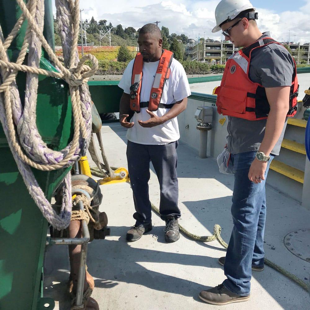 Cortland engineers assessing rope on tugboat